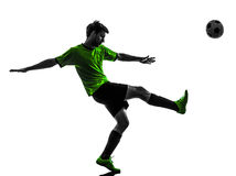 Soccer football player young man kicking silhouette Royalty Free Stock Image