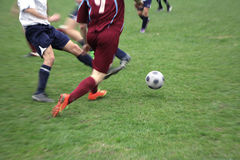 Soccer or football. Players in action on the field Stock Photos