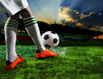 Soccer football players kicking to soccer ball Royalty Free Stock Image