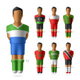 Soccer / football players in national flags unifor Royalty Free Stock Images