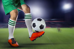 Soccer football players and soccer ball with motion blur of spor Stock Images