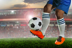 Soccer football players in sport stadium field against fan club Royalty Free Stock Images