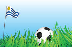 Soccer or football playground, uruguay. An illustrations of soccer ball, with a uruguay flag waving at the background Royalty Free Stock Photos