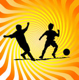 Soccer or football poster. Silhouettes of two soccer or football players with a ball on a glowing swirling, radiant background Stock Photos
