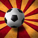 Soccer football on ray background. Use as theme background Royalty Free Stock Image