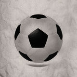 Soccer football on recyccle paper texture Stock Images