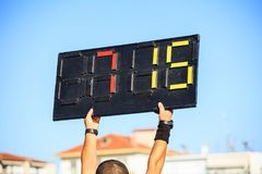 Soccer football referee assistant with board substitution Royalty Free Stock Images