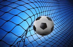 soccer football shoot into goal net Stock Images