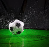 Soccer football on splashing water use for sport ball equipment background Stock Images