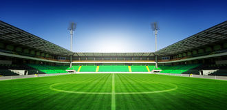Soccer Football stadium with blue sky. Setting sun Royalty Free Stock Photography