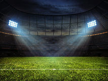 Soccer football stadium with floodlights. Sport concept background - soccer footbal stadium with floodlights. Grass football pitch with mark up and soccer goal