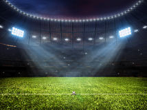 Soccer football stadium with floodlights. Sport concept background - soccer footbal stadium with floodlights. Grass football pitch with mark up and soccer goal Royalty Free Stock Photos