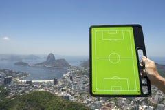 Soccer Football Tactics Board Rio de Janeiro Brazil. Hand holding soccer football tactics board above skyline overlook of Rio de Janeiro Brazil Stock Image