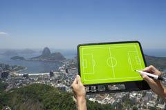 Soccer Football Tactics Board Rio de Janeiro Brazil. Hands holding soccer football tactics board and pen above skyline overlook of Rio de Janeiro Brazil Royalty Free Stock Photo