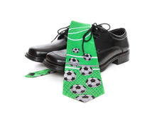 Soccer (Football) Tie and Shoes. A business man's shoes and a soccer (football) themed tie over white background Royalty Free Stock Photography