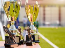 Football Trophies, Awards. Golden Cups and Kids Football Trophies royalty free stock photo