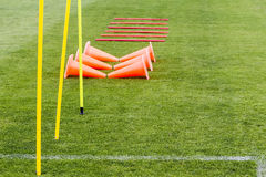 Soccer (football) training equipment on the green field of the s Royalty Free Stock Photo