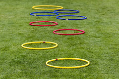 Soccer (football) training equipment on the green field of the s Royalty Free Stock Photos