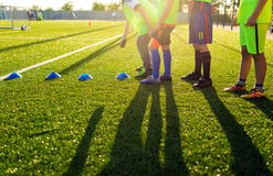 Soccer Football Training Session for Kids. Boys Training Footbal. L on the Pitch. Soccer Stadium in the Background royalty free stock photography