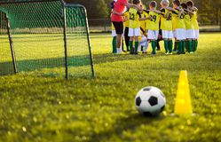 Soccer football training for young boys. Training session on the grass soccer field royalty free stock photography