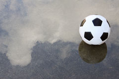 Soccer football on wet ground Royalty Free Stock Photo