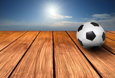 Soccer football and wood terrace Royalty Free Stock Photos