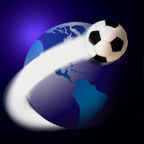 Soccer football and the world or globe. Map or globe with coloured land areas showing the ammerican sections of landmass with a soccer football and flare Royalty Free Stock Photo