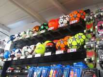 Soccer footballs in a sports store. Stock Photo