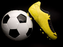 Soccer footwear on the ball Stock Images