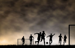 Soccer game. Editable  illustration of men playing football with sky made using a gradient mesh Stock Images