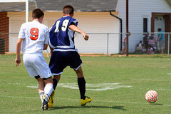 Soccer Game. Two soccer players competing for the ball Royalty Free Stock Images