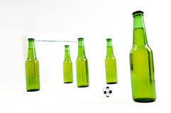 Soccer Game. Beer bottles playing soccer game Royalty Free Stock Images