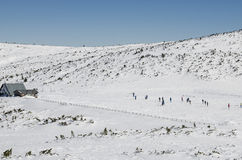 Soccer game at the chalet. People playing soccer in winter on the Bucegi Mountains Plateau near the Piatra Arsa Chalet, , Romania Stock Image