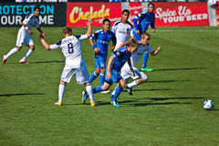 Soccer game Earthquakes vs LA Galaxy. SANTA CLARA, CA - JUNE 25: Players Chris Birchall (8), Michael Stephens (26) and Brad Ring (5) compete during the MLS Royalty Free Stock Photos