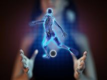 Soccer game player on hologram Stock Photography