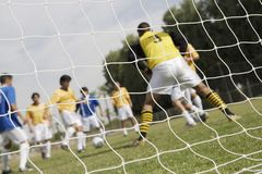 Soccer Game Seen Through Net Royalty Free Stock Images