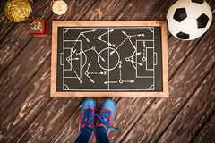 Soccer game strategy. Blackboard with drawn soccer game strategy. Ball, trophy and medal Stock Photography