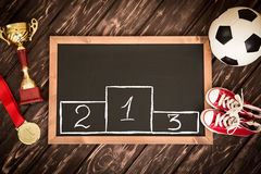 Soccer game strategy. Blackboard with drawn soccer game strategy. Ball, trophy and medal Stock Photos