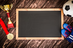 Soccer game strategy. Blackboard with drawn soccer game strategy. Ball, trophy and medal Royalty Free Stock Photos
