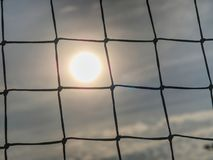 Soccer gate with sunset. Detail of tennis net on court stock image