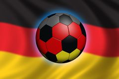 Soccer in Germany. Soccer ball and flag of germany (flag out of focus Royalty Free Stock Image