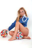 Soccer girl. Young model with a soccer ball Royalty Free Stock Image