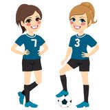 Soccer Girl Players. Two beautiful soccer girl players with black and blue uniform Stock Image