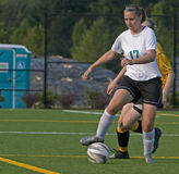 Soccer Girls varsity 17. High School girls varsity player moving down the field with the ball Stock Photo