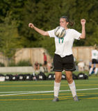 Soccer Girls varsity 4. High School girls varsity player stopping the ball to gain control Royalty Free Stock Photo