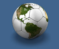 Soccer Globe on Blue. White soccer ball with the continents, on blue background Stock Photos
