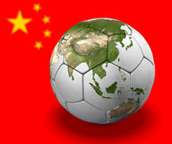 Soccer Globe: China. Soccer ball depicted as a globe, on background of Chinese flag. Asian continent is on globe Royalty Free Stock Images