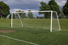 Soccer Goal. A view of a net on a vacant soccer pitch Stock Photos