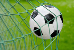 Soccer goal!. Close-up of a soccer ball flying into the net stock images