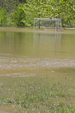 Soccer Goal Amid a Flooding River Royalty Free Stock Images